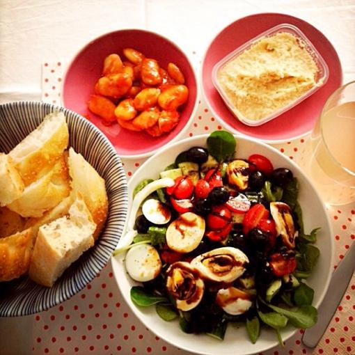 green salad with humus, white giant beans and pita bread